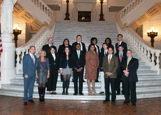 Students with elected officials in the Capitol entryway